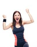 Mujer deportiva que celebra su victoria Foto de archivo libre de regalías
