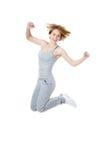 Mujer deportiva que salta con alegría Imágenes de archivo libres de regalías