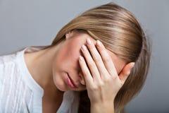 Mujer deprimida Imagen de archivo libre de regalías