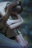 Mujer deprimida joven Fotografía de archivo libre de regalías