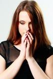 Mujer deprimida joven que mira abajo Imagenes de archivo