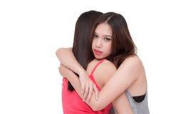 Mujer deprimida que abraza a su amigo Foto de archivo libre de regalías