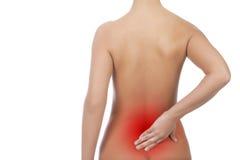 Mujer descubierta con dolor de espalda Imagen de archivo libre de regalías