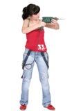 Mujer divertida con un taladro Foto de archivo
