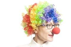Mujer divertida del payaso, femenina con las lentes imagen de archivo libre de regalías
