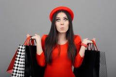 Mujer divertida sorprendida con los panieres Fotografía de archivo libre de regalías
