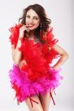 Mujer divertida traviesa en traje teatral rojo Fotografía de archivo