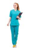 Mujer-doctor joven con la carpeta foto de archivo libre de regalías
