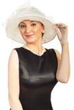 Mujer elegante con el sombrero Fotografía de archivo