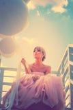 Mujer elegante con los baloons Foto de archivo libre de regalías