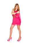 Mujer elegante joven con una alineada rosada Fotos de archivo
