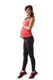 Mujer embarazada alegre que ejercita aeróbicos Imágenes de archivo libres de regalías