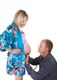 Mujer embarazada con el aislante del hombre Imagen de archivo libre de regalías