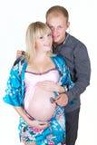 Mujer embarazada con el aislante del hombre Foto de archivo libre de regalías