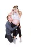 Mujer embarazada con el aislante del hombre Fotografía de archivo libre de regalías
