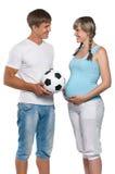 Mujer embarazada con el marido Foto de archivo libre de regalías