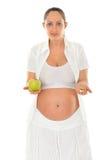 Mujer embarazada con el vidrio de agua Fotografía de archivo