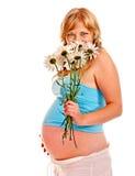 Mujer embarazada con la flor Imágenes de archivo libres de regalías