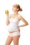 Mujer embarazada con la manzana Imagen de archivo