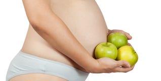 Mujer embarazada con las manzanas Fotos de archivo libres de regalías