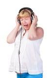 Mujer embarazada con los auriculares Imagen de archivo libre de regalías