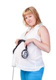 Mujer embarazada con los auriculares Foto de archivo libre de regalías