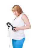 Mujer embarazada con los auriculares Foto de archivo