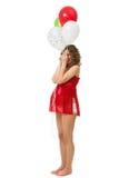 Mujer embarazada con los globos foto de archivo libre de regalías