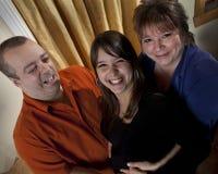 Mujer embarazada con sus padres Imagenes de archivo