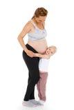 Mujer embarazada de los jóvenes con la hija Fotografía de archivo libre de regalías