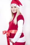 Mujer embarazada del pánico con el sombrero de la Navidad Imagen de archivo libre de regalías