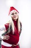 Mujer embarazada del pánico con el sombrero de la Navidad Fotografía de archivo