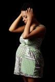 Mujer embarazada deprimida Foto de archivo