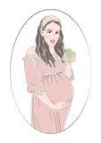 Mujer embarazada en círculo Foto de archivo libre de regalías