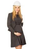 Mujer embarazada en el casco blanco Imágenes de archivo libres de regalías