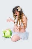 Mujer embarazada en el fondo blanco Fotos de archivo libres de regalías