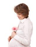 Mujer embarazada en el fondo blanco (aislado) Foto de archivo