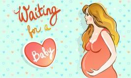 Mujer embarazada feliz que espera a un bebé Foto de archivo libre de regalías