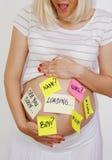 Mujer embarazada hermosa que cuenta con concepto Foto de archivo libre de regalías