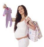 Mujer embarazada que hace compras. Imágenes de archivo libres de regalías
