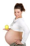 Mujer embarazada y alimento sano imágenes de archivo libres de regalías