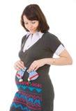 Mujer embarazada y bootee Foto de archivo libre de regalías