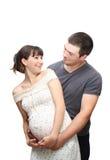 Mujer embarazada y el hombre, aislado. Imagen de archivo libre de regalías