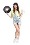 Mujer emocionada con el disco de vinilo que muestra a Victory Sign Imágenes de archivo libres de regalías