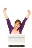 Mujer emocionada con la computadora portátil Fotografía de archivo libre de regalías