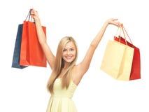 Mujer emocionada con los bolsos de compras Imagen de archivo libre de regalías