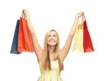Mujer emocionada con los panieres Imágenes de archivo libres de regalías
