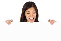Mujer emocionada de la cartelera Fotos de archivo