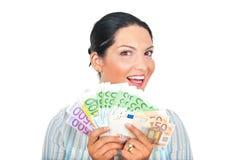 Mujer emocionada que muestra el dinero Foto de archivo libre de regalías