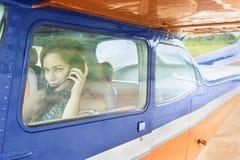Mujer en aeroplano Imagen de archivo libre de regalías